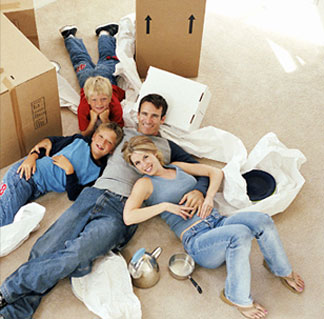 happy-family-laying-on-boxes
